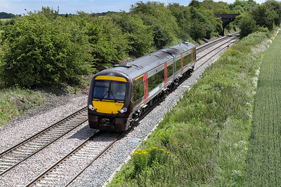 The 13.19 Birmingham New Street to Nottingham is formed of 2 car Turbo No. 170111 passing Willow Bottom Lane, Portway.