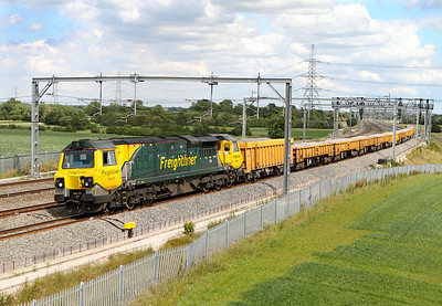 Freightliner's Class 70 No. 70005 heads north at Lichfield Trent Valley with 6Z22 13.28 Stud Farm to Calisle Virtual Quarry loaded ballast.