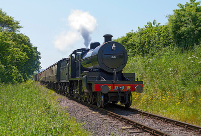 S & D 2-8-0 No. 88 passes Kentsford Farm Crossing with the 12.45 Minehead to Bishops Lydeard. Saturday 8th June 2013.