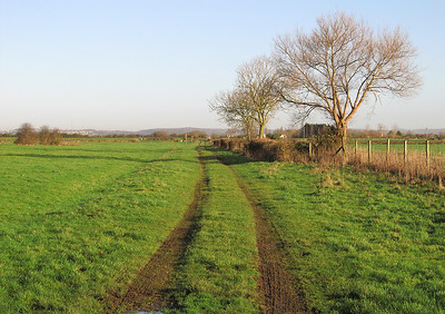 The site of Wick St Lawrence station looking towards the River Yeo crossing and in the distance Clevedon. The wooden station building was on the left with a loop on the left just past the station and a small spur on the right. The line passes just to the left of the two radio masts which can be seen in the distance at Colehouse Lane.