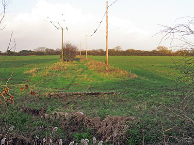The trackbed between Station Road Worle and the River Banwell bridge has been swallowed up by the housing estates of North Worle. But where it reappears, the bridge abutments are still visible on the north bank of the river. This is the view looking towards Ebdon Road Crossing.