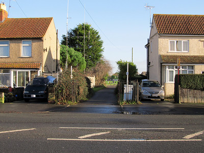 The view looking in the opposite direction from Milton Road station. The line passed between the houses and crossed Baytree playing fields before diverging to the right and crossing Locking Road.