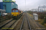 The reason for the Bubblecar to be travelling down on the up relief soon became clear as it passed a Class 66 running light engine up on the down relief! The relief lines here are dropping downhill to reach the flyunder across the mainlines to reach the yards on the right of the picture. 11:27, Thursday 4th February 2010. Digital Image No. GMPI4422.