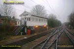 The bubblecar was held at Acton Wells for around 30 minutes and by the time the train got the road the weather had deteriorated even further - sadly the windscreen wipers are none too good! Having come off the Cricklewood lines the train joins the Willesden SW sidings lines for a few  yards and then trails into the lines from Willesden High Level in front of the signalbox. This is a former LNWR box, again, much modified over the years. The line crosses over the GWR line from Paddington to Birmingham and also the Central Line tracks on the bridge in the middle distance, then the bubblecar will take the tracks to the right to reach Acton Main Line on the GWML. 12:21, Thursday 4th February 2010. Digital Image No. GMPI4449.