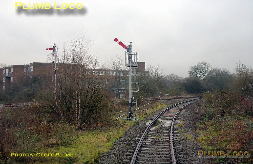 """At the top of the curve from Neasden South Junction, the line trails into the former Midland Railway line from Cricklewood to Acton Wells Junction at Neasden Junction. The signal is """"off"""" for the bubblecar to enter the junction, this signal, NJ4, being Neasden Junction's Home signal on the former Great Central spur. The equivalent Home signal protecting the junction on the Cricklewood line can be seen to the left, and is of course """"on"""". 11:15, Thursday 4th February 2010. Digital Image No. GMPI4384."""