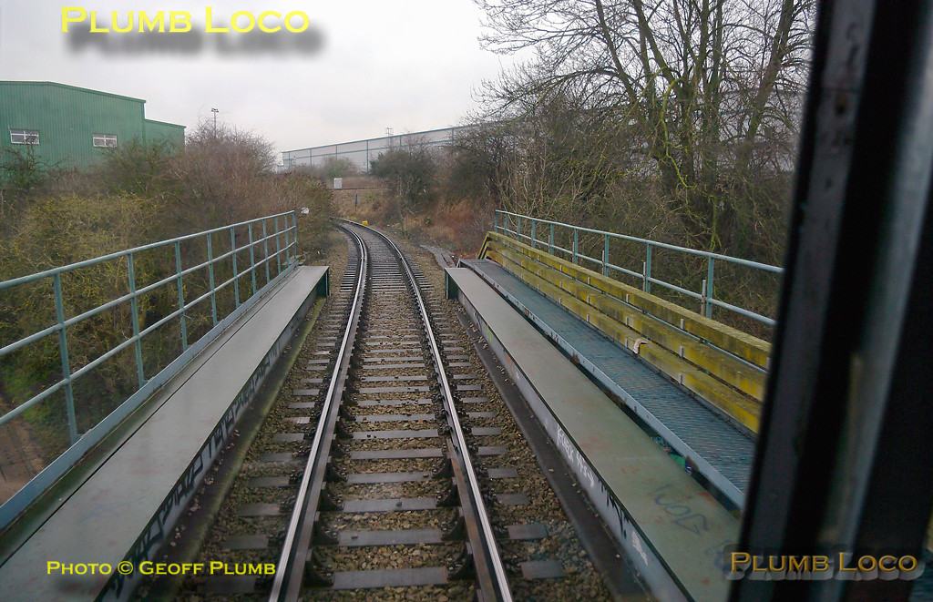 960014 is now travelling up the branch from Acton Branch Junction to Acton Canal Wharf Junction and here is crossing the bridge over the Grand Union Canal, the Cricklewood lines above and to the right. 11:39, Thursday 4th February 2010. Digital Image No. GMPI4441.