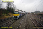 The rain on the windscreen of the bubblecar produces a rather distorted picture as it heads west along the down relief line alongside Acton Yard on the right. A Heathrow Express 332 unit heads into Paddington an the adjacent up fast line. 12:26, Thursday 4th February 2010. Digital Image No. GMPI4461.
