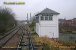 The bubblecar is now coming off the Neasden Curve at Neasden Junction and the road is set for the crossover to the down Cricklewood line. The former Midland Railway signalbox has been somewhat modified over the years but still shows its parentage, even with finials still in place. 11:15, Thursday 4th February 2010. Digital Image No. GMPI4387.