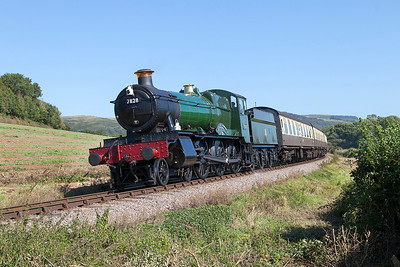 7828 'Norton Manor' passes Woolston farm crossing working the 14.45 Norton Fitzwarren to Minehead. Sunday 31st August 2014.