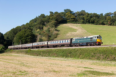 D6575 climbs past Castle Hill with the 15.45 Minehead to Bishops Lydeard. Sunday 31st August 2014.