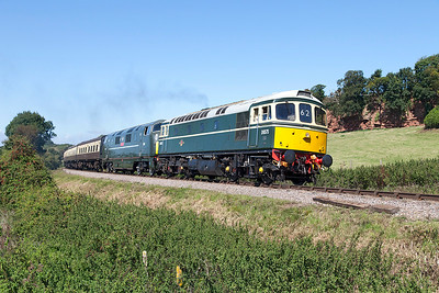 D6575 & D832 'Onslaught' climb past Woolston farm crossing with the 11.45 Minehead to Bishops Lydeard. Sunday 31st August 2014.
