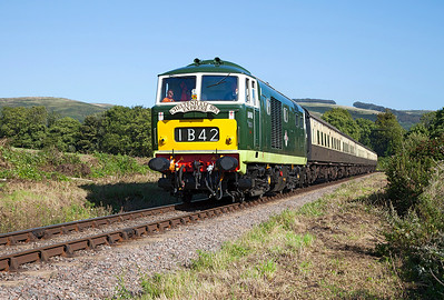 D7017 passes Woolston working the 15.45 Bishops Lydeard to MInehead. Sunday 31st August 2014.