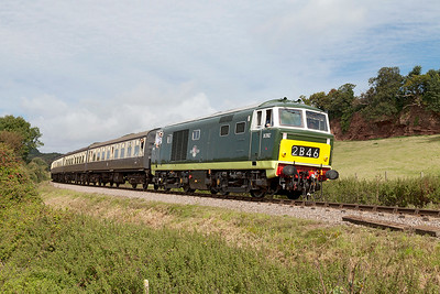 D7017 passes Woolston farm crossing working 09.45 Minehead to Bishops Lydeard. Sunday 31st August 2014.