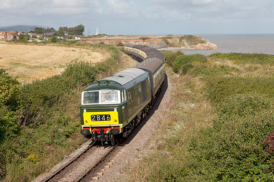 D7017 passes Doniford Halt working 09.45 Minehead to Bishops Lydeard. Sunday 31st August 2014.