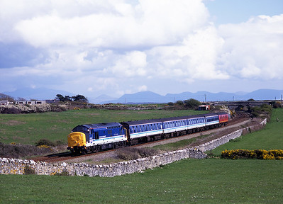 37420 hauls the 14.24 Crewe-Holyhead near Rhosneiger on 4/5/96