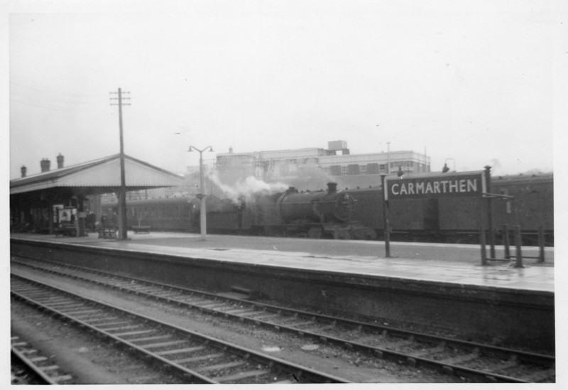 Missed opportunity. On 21/03/64 at Carmarthen sees the arrival of the 07 15 ex Aberystwyth, a line that closed in January 65, with home based 7815 Fritwell Manor - herself withdrawn at Gloucester in the October of that year.