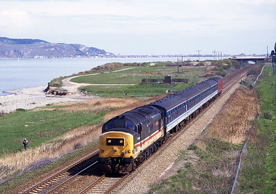 The 10.24 Crewe-Bangor approaches Penmaenmawr behind 37405 on 4/5/96.