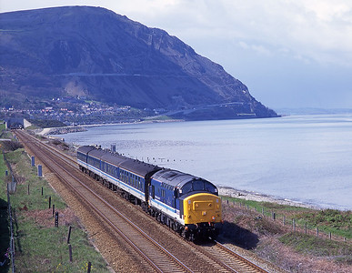 37420 hauls the 11.31 Bangor-Crewe near Penmaenmawr 4/5/96.
