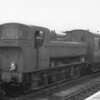 Home based ex GWR 2F 0-6-0PT 1668 shunts stock at Oswestery on 14/11/64 - with just weeks to live.