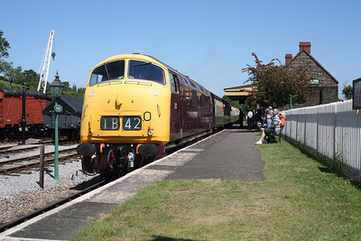 A cloudless sky finds D832 calling at Washford with a Minehead-bound train. 12/6/10