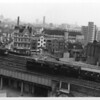 "Taken from ""those flats"" is Nine Elms's WC 34021 Dartmoor, with whom I was able to accumulate over 1,000 miles, approaching the terminus with the 10 08 from Bournemouth West on 20/05/65. The Lower Marsh market's cafe's seen in the background were much frequented by myself each lunchtime - never getting to my Kent home until late because of my steam commuting activities each evening into Surrey/Hampshire."