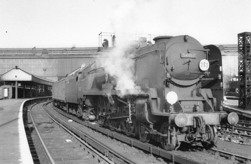 The 13 30 for Weymouth with Eastleigh's Light Pacific 34017 Ilfracombe at the head. Taken on 03/11/65 she was withdrawn from Nine Elms one year later.