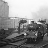 Taken from the end of platform 11 BR Standard 4MT 80143 of Nine Elms storms away from Waterloo with a single van in Feb 65.