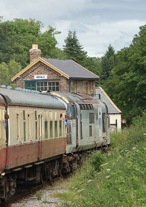 37250 passing Bedale signal box on 24th June 2012.