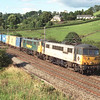 86615 Rotary International and 86631 descend towards Oxenholme with the evening freightliner, 19/7/2000.