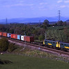 86610 and 86604 pass Strickland with a Coatbridge to Crewe freightliner, 3/5/2011.