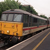 86259 Greater Manchester the Life & Soul of Britain (the former Peter Pan) stands ready to depart Oxenholme 23/6/1998.