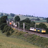 86607 and 86622 scream past Lambrigg on the climb to Grayrigg with 4S52 Crewe to Coatbridge freightliner, 25/7/2006.
