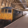 West Coast thoroughbred goes east.<br /> 86101 Sir William Stanier stands in platform 7 at Kings Cross ready to depart propelling 1G03 09:34 Kings Cross to Doncaster Hull Trains service, 12/4/2008.