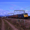 86101 Sir William Stanier swings on the rear while 87002 Royal Sovereign does the business up front as they cruse through Prestonpans on the ECML with a GBRF Staff tour from Retford to Edinburgh 23/7/2011