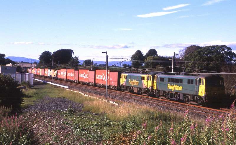 After their booked stop in Tebay loop 86639 and 86622 scream passed Elmsfield with the Coatbridge to Crewe freightliner, 21/7/2014.