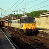 86610 and 86622 storm through Oxenholme with a south bound liner, 30/4/1999.