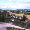 86631 and 86609 scream up the climb to Grayrigg north of Oxenholme with 4S50 06:02 Bassford Hall to Coatbridge freightliner, 20/8/2003.<br /> Just under 2 months after this picture was taken 86631 along with 86611 Airey Neave were involved in the Norton Bridge crash on the 16th October and was damaged beyond repair.