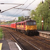 86426 Pride of the Nation storms through Oxenholme with 1V04 Shieldmuir - Bristol mail vans, which on this occasion for some reason had a TPO stowage van in the consist, 16/5/2001.
