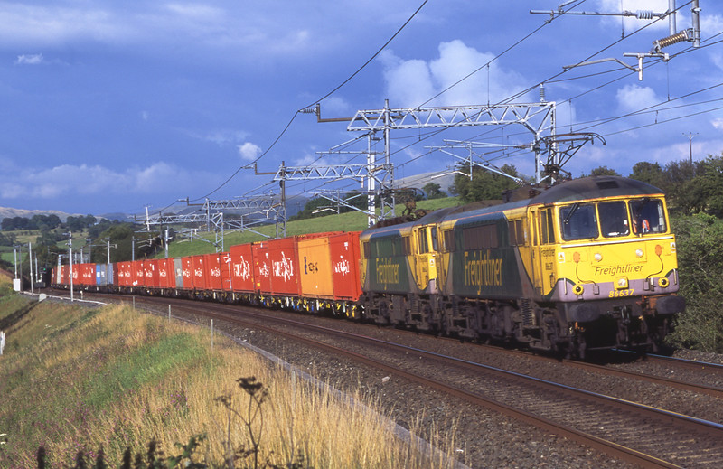 86637 and 86627 scream passed Lambrigg with the evening freightliner, 7/8/2015.