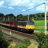 86258 Talyllyn approaches Oxenholme with the 12:30 Glasgow-Poole, 16/8/2000.