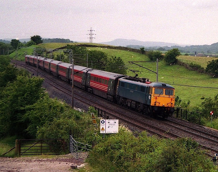BR Blue 87001 Stephenson lifts the 12:30 Euston to Glasgow service out of Oxenholme on the climb to Grayrigg, 1/7/2003.