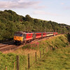 "86242 James Kennedy G.C. lifts its train out of Oxenholme passed the ""Tidy spot"", 14/7/2000."