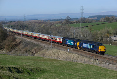 37607+37218 storm past Great Strickland with Pathfinder's Easter Chieftain returning from Inverness to Eastleigh 6/4/15.
