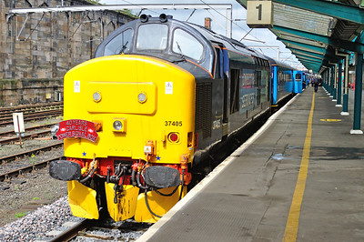 A charity railtour was organised to commemorate 40 years of Carlisle Power Signal Box on 10/5/14, covering local freight lines and loops.  37405 stands in platform 1 just before departure complete with headboard.  37425 was at the other end.