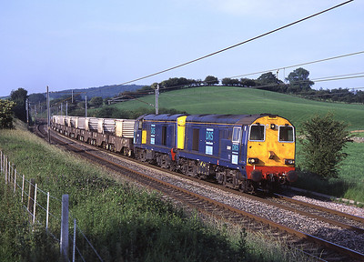 20309 + 20307 head a diverted monster flask train (load 9) near Sedgwick 30/6/06.