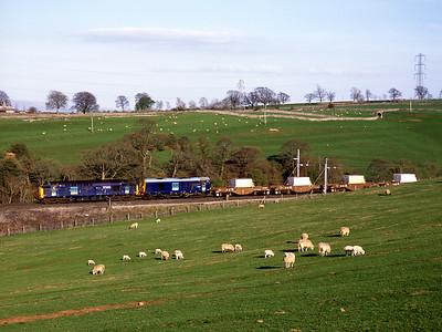 37602 + 20305 haul the diverted Heysham flasks past Great Strickland 3/5/06.