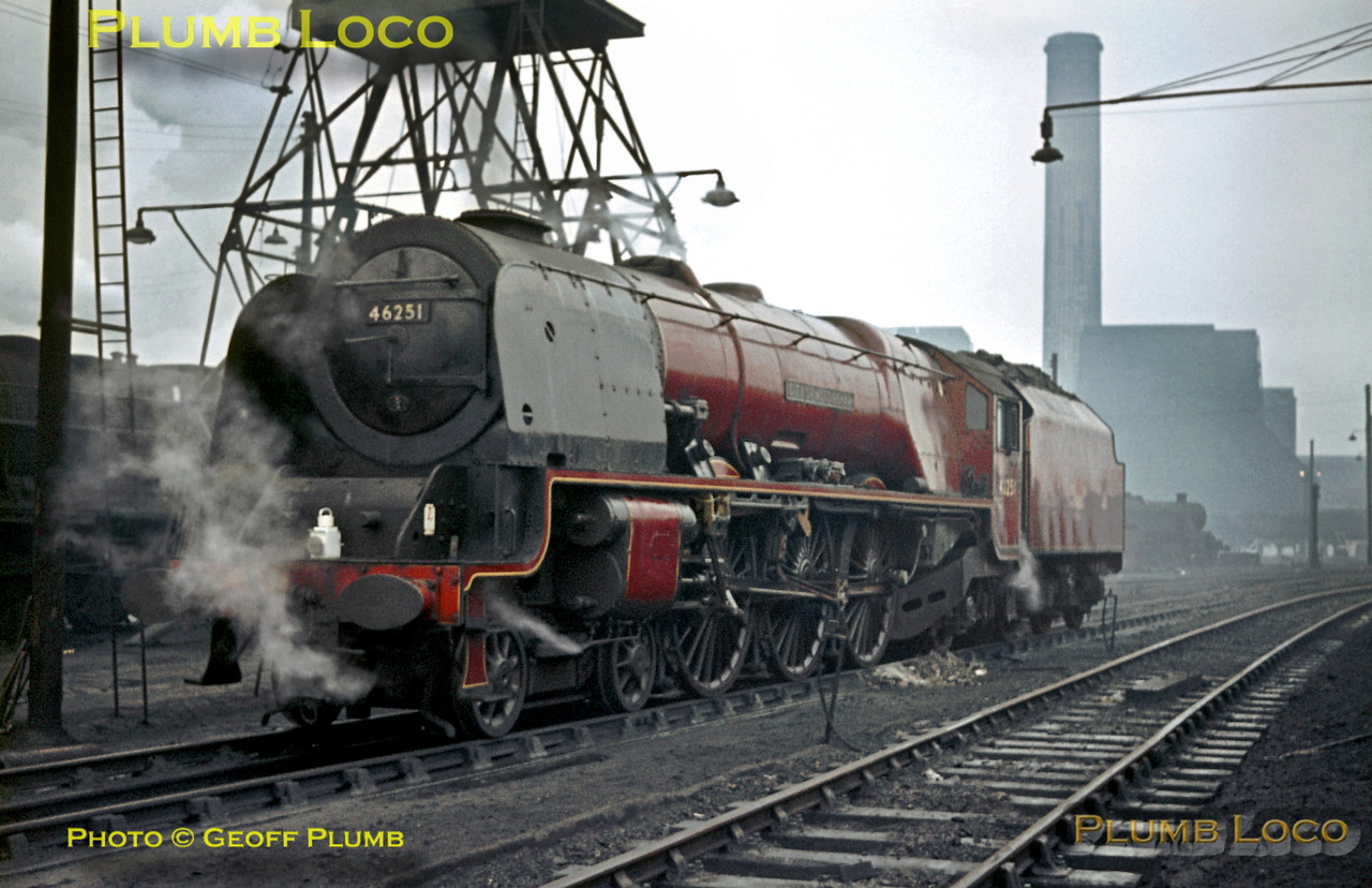 "On an utterly miserable day, Sunday 5th January 1964, Stanier ""Princess Coronation"" Class 4-6-2 No. 46251 ""City of Nottingham"", stands by the ash disposal facilities at Willesden MPD. Compared to many engines by this time, she is in commendably clean external condition, carrying LMR maroon livery. Slide No. 482."