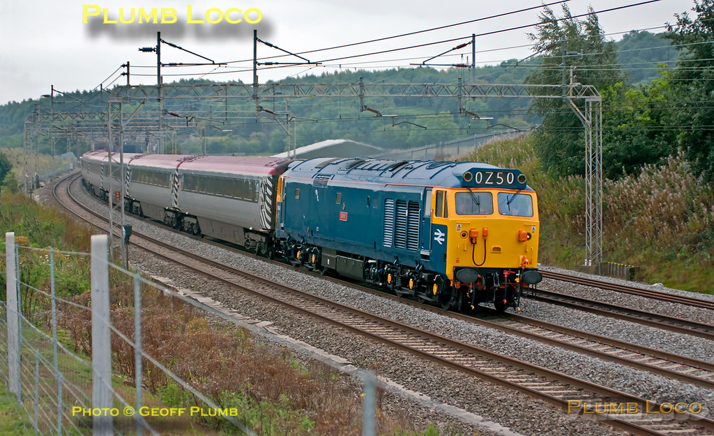 """With the weather back to its normal dull and miserable, 50044 """"Exeter"""" is heading north along the down slow at Old Linslade with 1Z50 (the displayed headcode denoting a light engine!), the 08:12 from Euston to Holyhead """"The Snowdon Ranger"""". This was a two-day tour, working to Llanrwst the following day before returning to Euston. It was originally planned to be operated by two Class 50s but 50049 was not available, so the train has 57304 """"Gordon Tracy"""" on the rear of the Virgin """"Pretendalino"""" set of Mk.3 coaches. 09:13, Saturday 3rd September 2011. Digital Image No. GMPI10228."""
