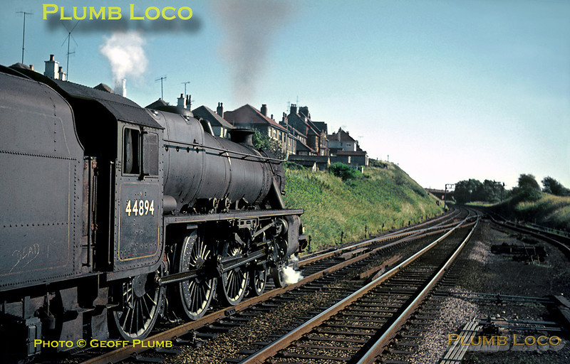 """""""Black 5"""" 4-6-0 No. 44894 looks quite smart as it draws its train to a stop at Hest Bank station on the afternoon of Thursday 21st July 1966. It is carrying Class 1 headcode lamps and the five coach train is the """"Lake Windermere Cruise"""", stopping here before setting off towards Morecambe. The engine has its 10A shedcode painted on the smokebox door, also """"Carnforth"""" painted on the bufferbeam to make doubly sure! Slide No. 2298."""