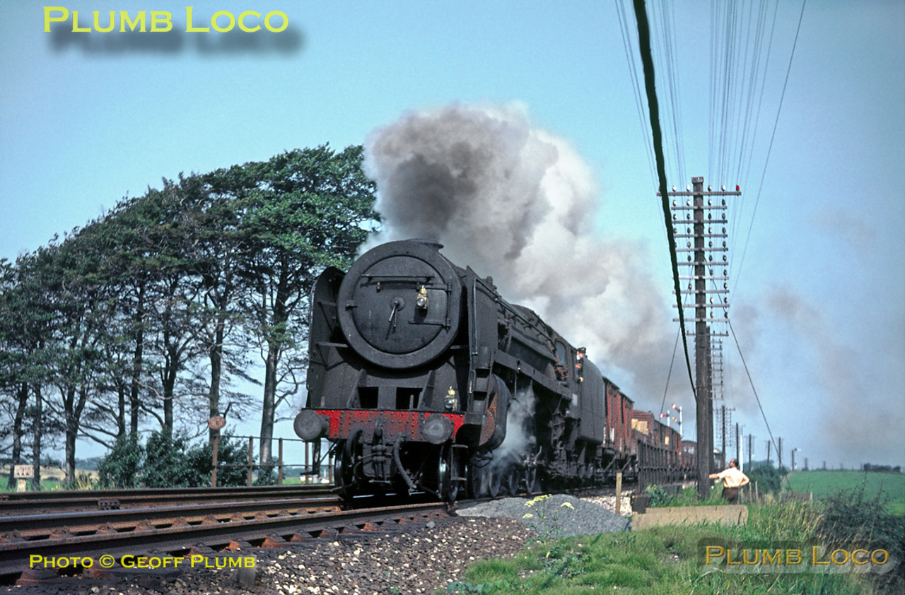 "BR Standard ""Britannia"" 4-6-2 No. 70032 ""Tennyson"" is working southwards with a Class F unfitted goods train near Morecambe South Junction, on a glorious summer day on Monday 21st August 1967. Slide No. 3016."